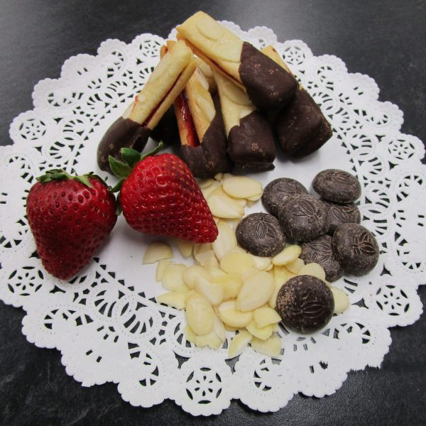 Mandelstängeli (chocolate-dipped almond bars filled with strawberry jam) with ingredients